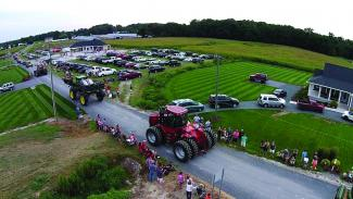 The Good Ole Boy Foundation puts on a tractor parade to fulfill a sick child's wish to drive a tractor.