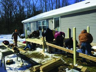 Good Ole Boy volunteers help build a wheelchair ramp  for someone in need.