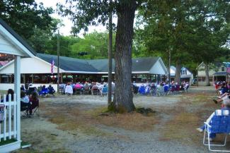Attendees gather in the circle to listen to an evening service.