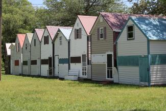 "For the twelve days of Carey's Camp, many attendees live in small cottages generally referred to as ""tents."""
